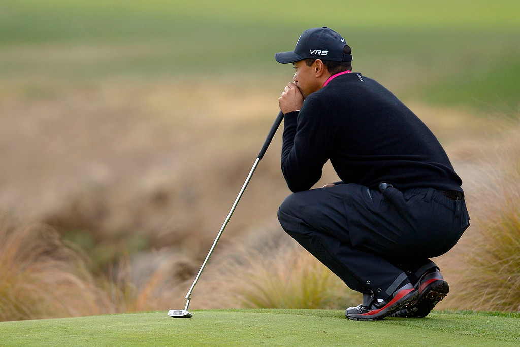 . Tiger Woods waits to putt on the second green during the second round of the Northwestern Mutual World Challenge golf tournament at Sherwood Country Club, Friday, December 6, 2013, in Thousand Oaks, Calif. (Andy Holzman/Los Angeles Daily News)