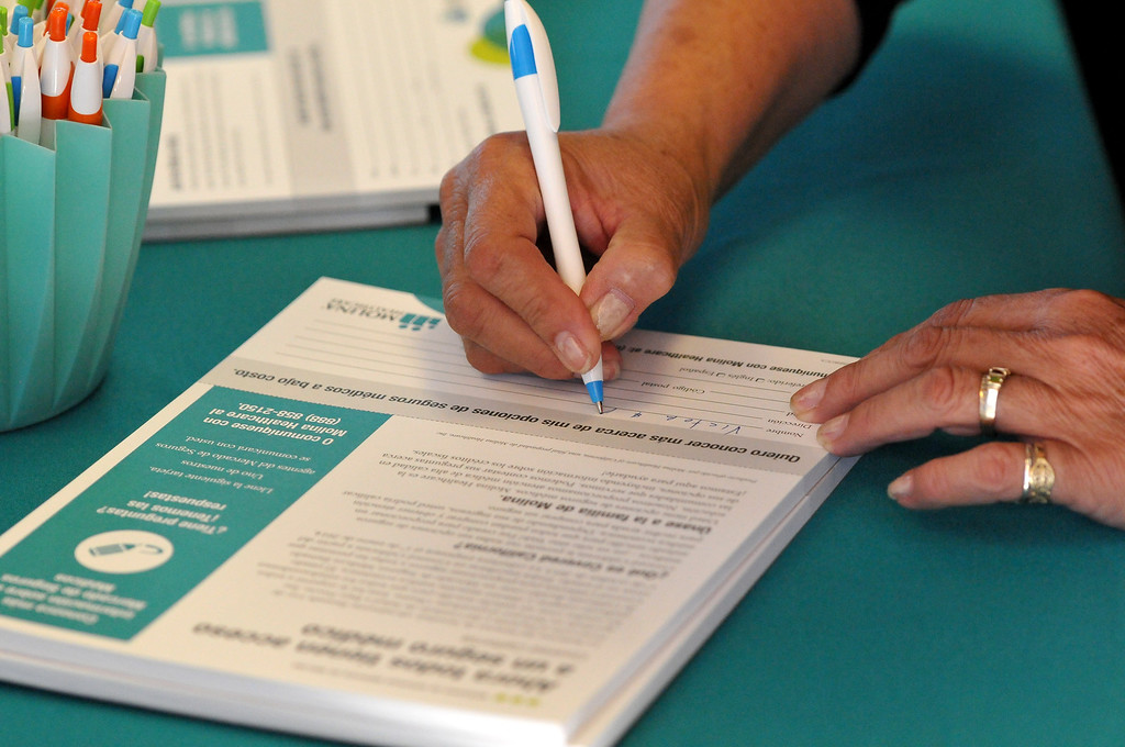 . (John Valenzuela/Staff Photographer) Alicia Gomez of Ontario signs-up to get more information about health insurance options with Covered California at Molina Medical in Fontana, Tuesday, Oct. 1, 2013. Today kick off the first day of open enrollment for Covered CA, the marketplace for affordable, private health insurance, Molina Medical  hosted an informational event for its patients and the Inland Empire community.