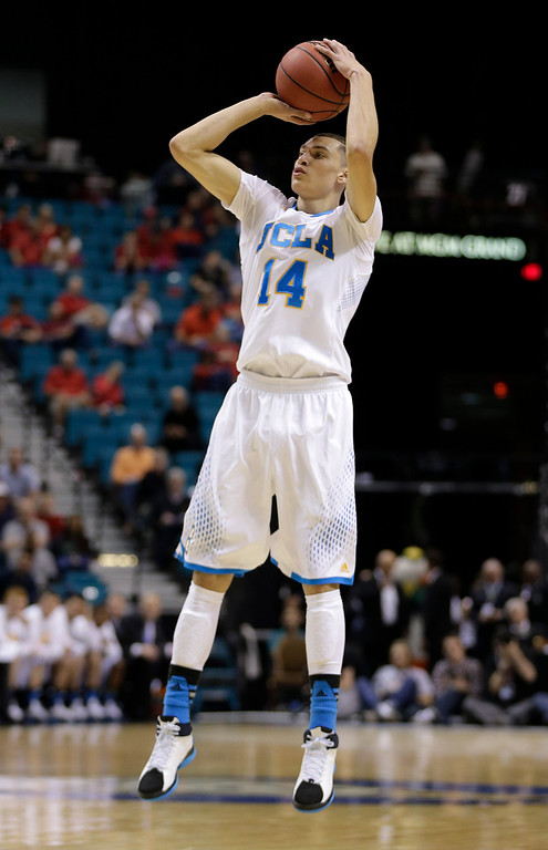 . UCLA\'s Zach LaVine puts up a shot against Oregon in the first half of an NCAA Pac-12 conference tournament quarterfinal college basketball game, Thursday, March 13, 2014, in Las Vegas. (AP Photo/Julie Jacobson)