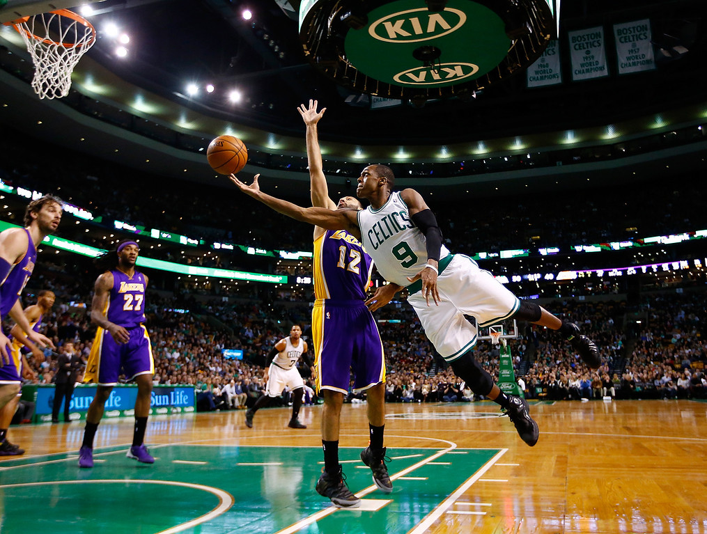 . BOSTON, MA - JANUARY 17:  Rajon Rondo #9 of the Boston Celtics is midair for a layup in front of Kendall Marshall #12 of the Los Angeles Lakers in the second quarter during the game at TD Garden on January 17, 2014 in Boston, Massachusetts.  (Photo by Jared Wickerham/Getty Images)