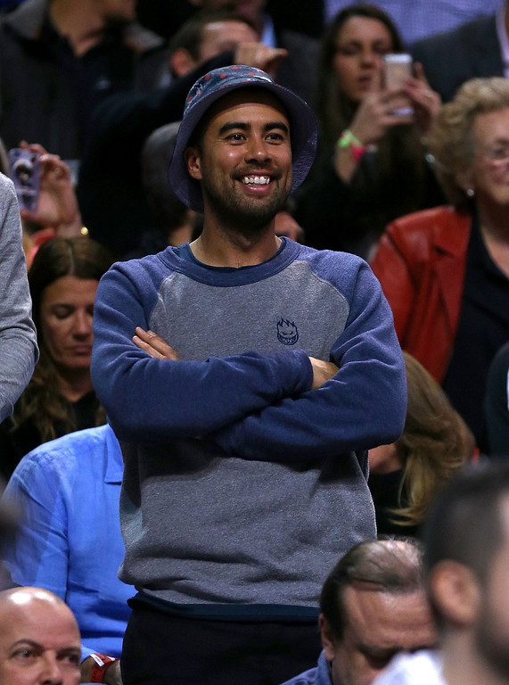 . Skateboarder Eric Koston watches a game between the Miami Heat and the Los Angeles Lakers during a game  at American Airlines Arena on January 23, 2014 in Miami, Florida.  (Photo by Mike Ehrmann/Getty Images)