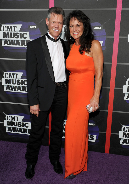 . Randy Travis, left, and Mary Beougher arrive at the 2013 CMT Music Awards at Bridgestone Arena on Wednesday, June 5, 2013, in Nashville, Tenn. (Photo by Frank Micelotta/Invision/AP)