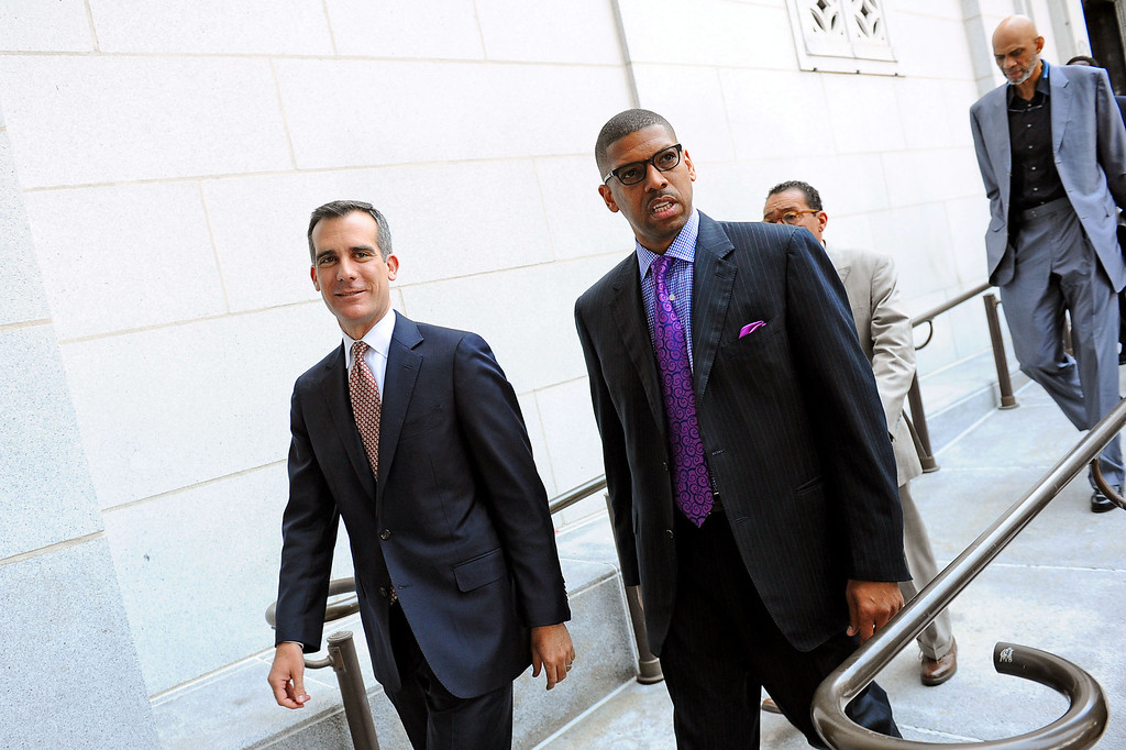. Sacramento mayor and former NBA player Kevin Johnson and Los Angeles mayor Eric Garcetti prepare to speak at a press conference at Los Angeles city hall regarding NBA Commissioner Adam Silver\'s banning of Donald Sterling for life from any association with the Clippers or the NBA  April 29, 2014.(Andy Holzman/Los Angeles Daily News)