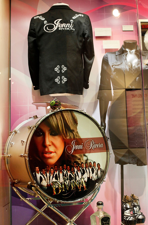 """. Mexican-American singer Jenni Rivera\'s costumes and memorabilia are displayed in a new exhibit: \""""Jenni Rivera, La Gran Senora,\"""" at the Grammy Museum at L.A. Live in Los Angeles on Friday, May 10, 2013.  The exhibit opened on Mother\'s Day, May 12, shows Rivera as the \""""Diva of Banda,\"""" due to her work within the banda and nortena music genres. Rivera, along with six others, died in a plane crash in Mexico, on Dec. 9, 2012. (AP Photo/Nick Ut)"""