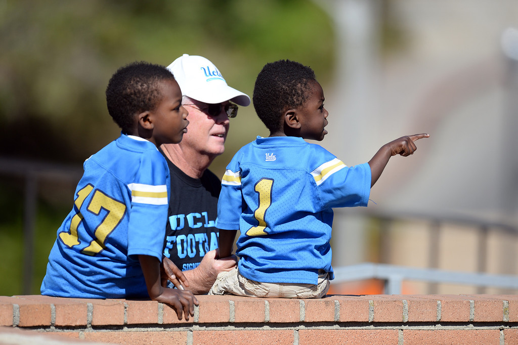 . Tommy and Nick Klug watch UCLA football practice with their uncle Jim Cox at  Spaulding Field on the UCLA campus Saturday 5, 2014.  (Photo by Hans Gutknecht/Los Angeles Daily News)