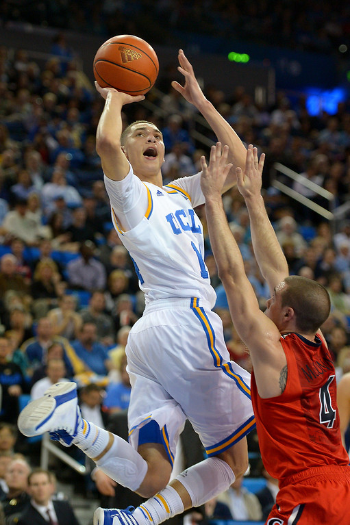 . UCLA\'s Zach LaVine shoots from the baseline against Arizona\'s T.J. McConnell in the first half, Thursday, January 9, 2014, at Pauley Pavilion. (Photo by Michael Owen Baker/L.A. Daily News)