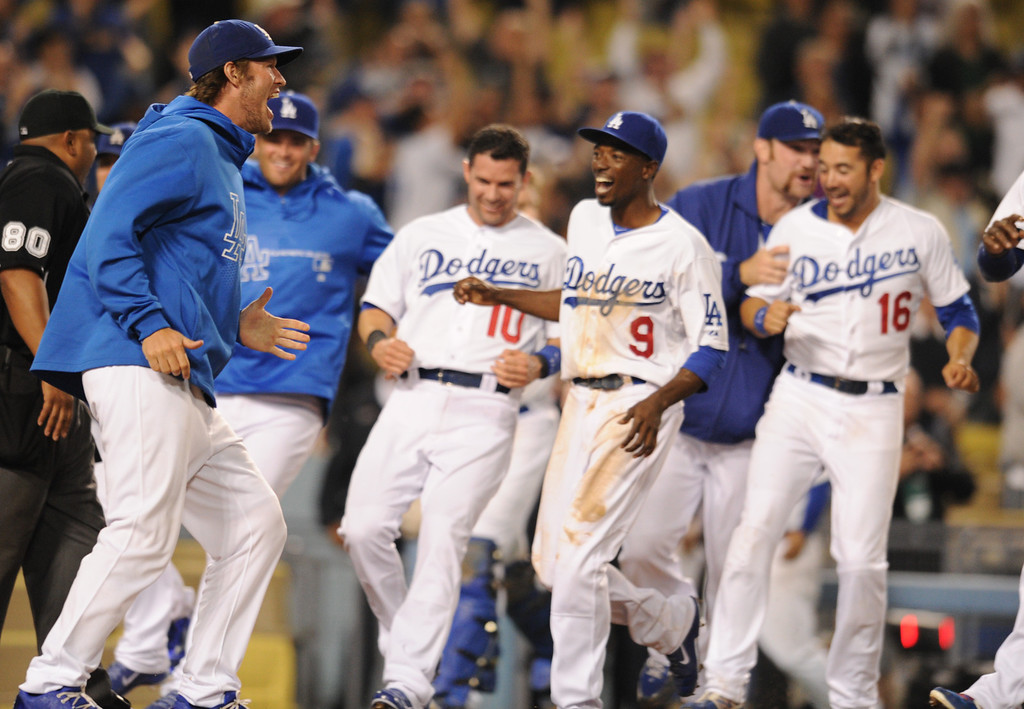. The Bench reacts at the end of the game. The Dodgers defeated the Arizona Diamondbacks 5-3 after Scott Van Slyke hit a 2 run walk off homer in the 11 inning at Dodger Stadium in Los Angeles, CA. 9/10/2013. photo by (John McCoy/Los Angeles Daily News)
