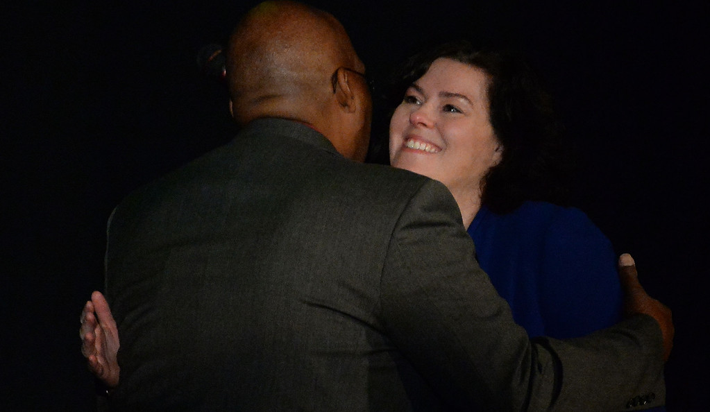 . Shawna Tennant, right, hugs Retired Pasadena Fire Dept. Capt. Byron Brown during a celebration of life service for former Pasadena Fire dept. Capt. and California State fire marshall, John Tennant at the Pasadena Civic Auditorium in Pasadena, Calif., on Wednesday, Feb. 5, 2014. (Keith Birmingham Pasadena Star-News)