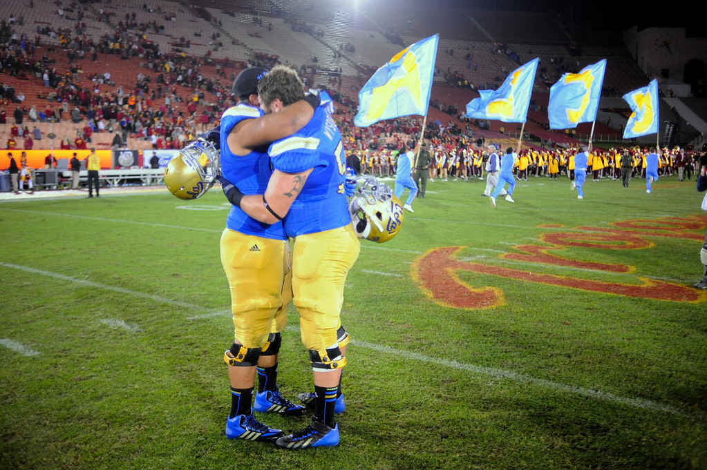 . UCLA players Ben Wysocki #55 and Xavier Su\'a-Filo #56 celebrate their victory over USC at the Los Angeles Memorial Coliseum Saturday, November 30, 2013.  UCLA beat USC 35-14. (Photo by Hans Gutknecht/Los Angeles Daily News)