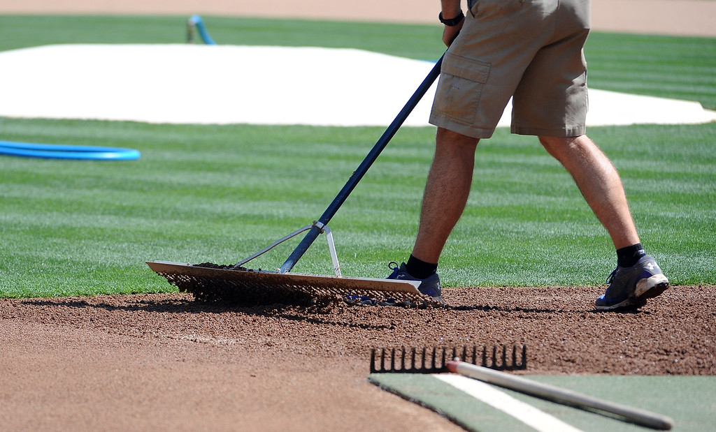 . Los Angeles Dodgers grounds crew prepares the field prior to a Major league baseball game against the San Francisco Giants on Saturday, May10, 2013 in Los Angeles.   (Keith Birmingham/Pasadena Star-News)