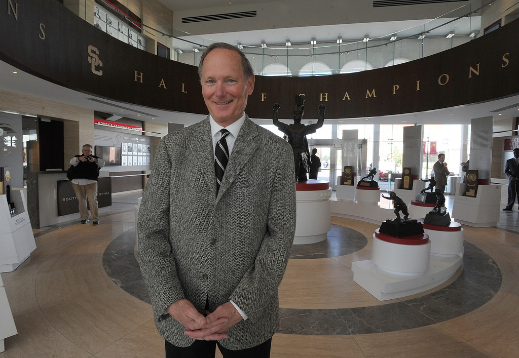 . USC Athletic Director Pat Haden stands in the Hall of Champions at Heritage Hall, which houses USC\'s athletic department. Heritage Hall has been closed for the past year while undergoing a $35-million renovation.  The building first opened in 1971 at a cost of $2.8 million and was originally 48,000 square feet. It now is 80,000 square feet. As part of the renovation, Heritage Hall\'s two-story lobby has been transformed into a state-of-the-art museum space featuring interactive displays. Heritage Hall also includes a sports performance center, a broadcast studio, a lounge for Women of Troy student-athletes, a rowing ergometer room and an indoor golf driving area, plus new locker rooms, meeting rooms, equipment room and event space.   Los Angeles , CA. January 30, 2014 (Photo by John McCoy / Los Angeles Daily News)