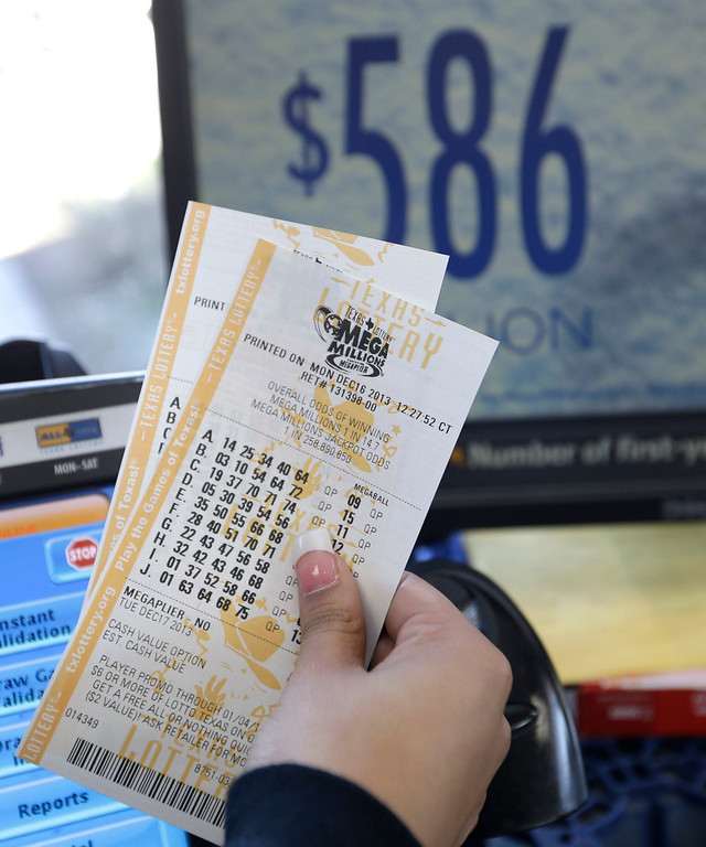 . Mega Millions lottery tickets are sold at the Fuel City convenience story Monday, Dec. 16, 2013, in Dallas. The Mega Millions jackpot soared to $586 million on Monday amid a frenzy of ticket purchases, a jump that pushed the prize closer to the $656 million U.S. record set last year. (AP Photo/LM Otero)