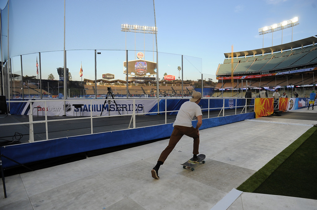 . A skateboarder rides around the ice before the 2014 NHL Stadium Series featuring the Los Angeles Kings taking on the Anaheim Ducks at Dodger Stadium January 25, 2014. (Photo by Hans Gutknecht/Los Angeles Daily News)