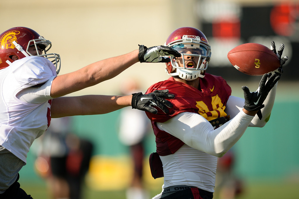 . USC TE Jalen Cope-Fitzpatrick catches a pass as LB Nick Schlossberg defends at practice, Thursday, March 27, 2014, at USC. (Photo by Michael Owen Baker/L.A. Daily News)