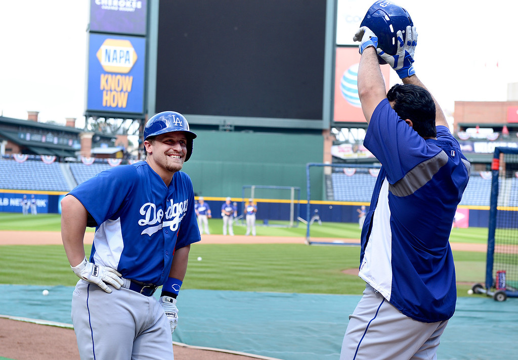 . Los Angeles\' Dodgers\' Tim Federowicz and Adrian Gonzalez wait in line to bat Wednesday, October 2, 2013as they get ready for the first playoff game against the Atlanta Braves Thursday at Turner Field in Atlanta, Georgia. (Photo by Sarah Reingewirtz/Pasadena Star- News)