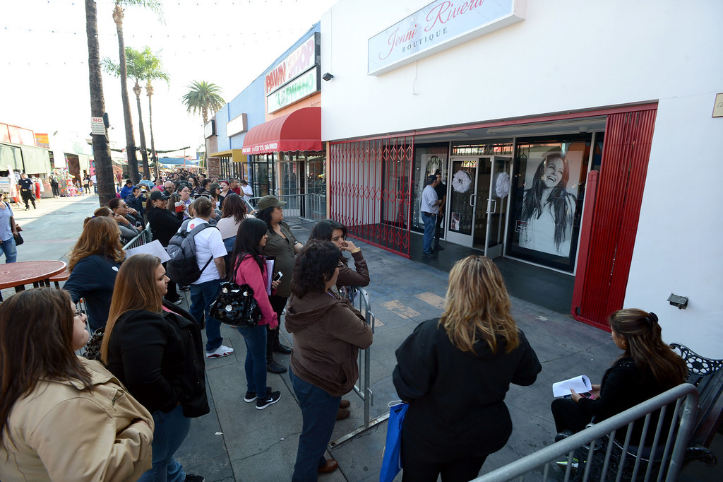 . Dec. 9 marks the one year anniversary of the death of singer Jenni Rivera. Jenni Rivera fans line up outside the Jenni Rivera Boutique in Panorama City,  for the release of her new live album, which was recorder just before her death after her plane crashed in Mexico.  Panorama City Calif., December 3, 2013.   (Photo by Stephen Carr / Daily Breeze)