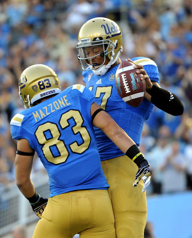 . UCLA QB Brett Hundley, right, celebrates with Grayson Mazzone after his 11-yard touchdown run in the second quarter against Colorado, Saturday, November 2, 2013, at the Rose Bowl. (Photo by Michael Owen Baker/L.A. Daily News)