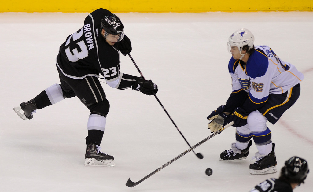 . The Kings Dustin Brown takes a shot against the St. Louis Blues. (Michael Owen Baker/Staff Photographer)