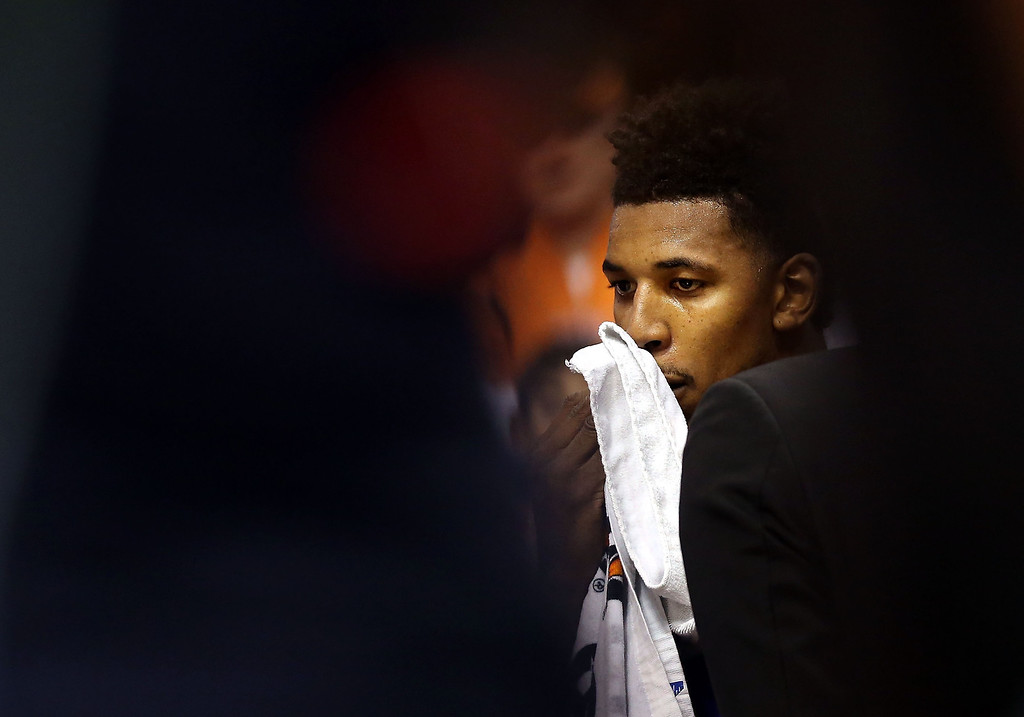 . Nick Young #0 of the Los Angeles Lakers reacts on the bench after scuffle with the Phoenix Suns during the first half of NBA game at US Airways Center on January 15, 2014 in Phoenix, Arizona.    (Photo by Christian Petersen/Getty Images)