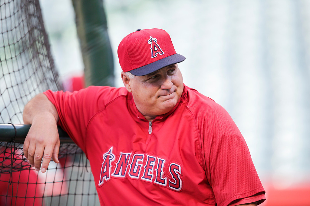 . Los Angeles Angels manager Mike Scioscia looks on before a baseball game against the Houston Astros on Friday, Aug. 16, 2013, in Anaheim, Calif. (AP Photo/Jae C. Hong)