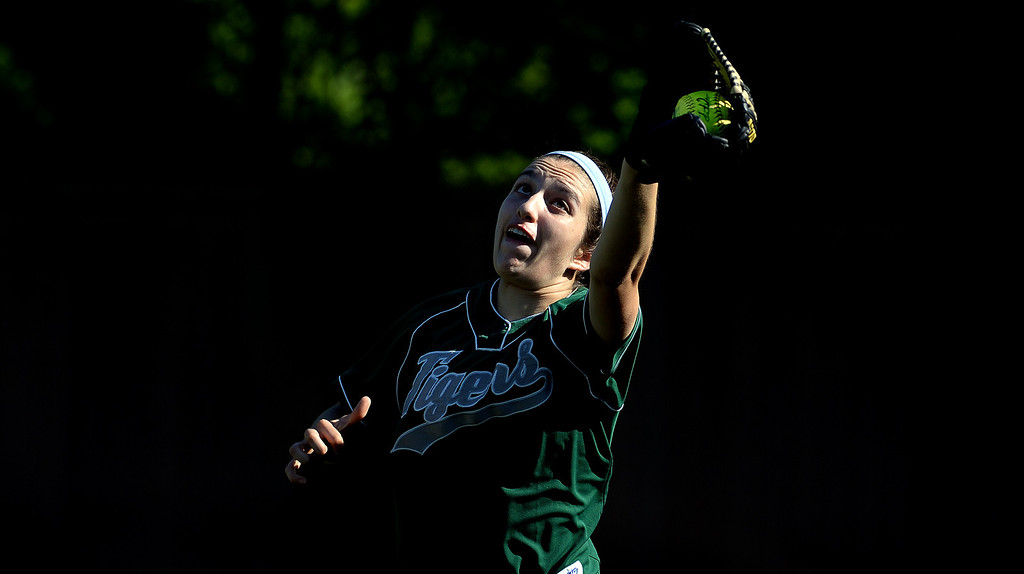 . Westridge right fielder Juliana Favela catches a fly ball by Poly Becca Hanel (not pictured) in the fifth inning of a prep softball game at Westridge High School in Pasadena, Ca on Tuesday, April 15, 2014. Poly won 11-1. (Keith Birmingham Pasadena Star-News)