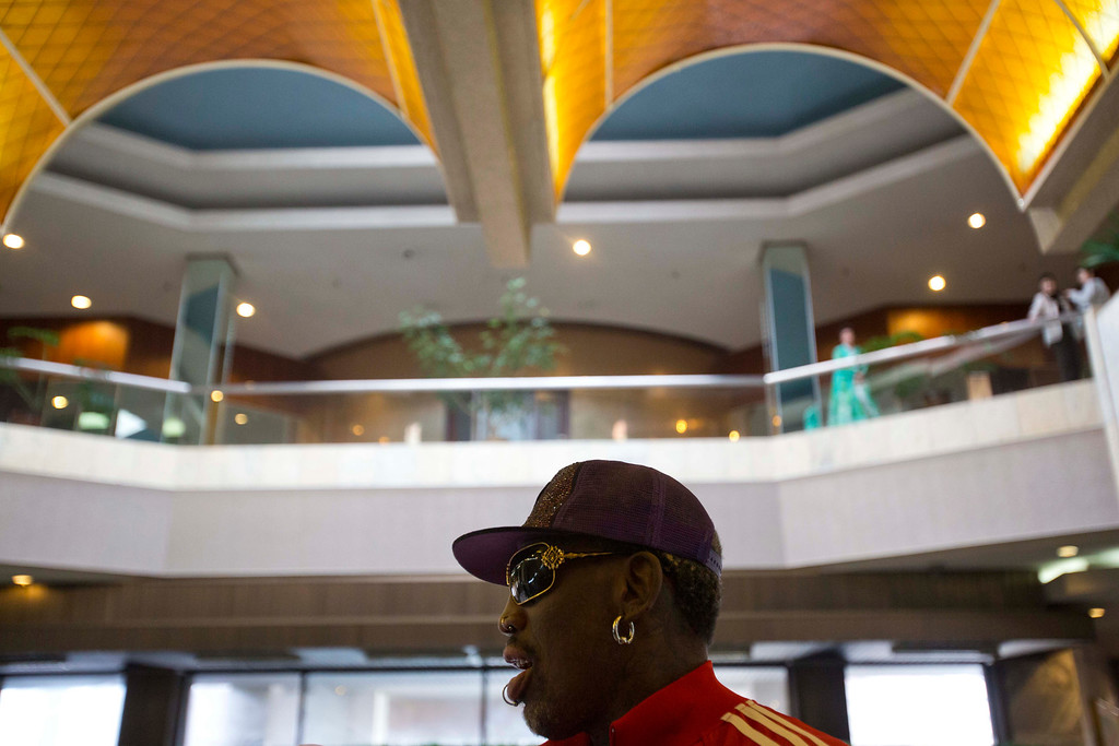 . Dennis Rodman arrives at his hotel in Pyongyang, North Korea after a morning practice session on Wednesday, Jan. 8, 2014. Rodman came to the North Korean capital with a team of USA basketball stars for an exhibition game on Jan. 8, the birthday of North Korean leader Kim Jong Un. (AP Photo/David Guttenfelder)