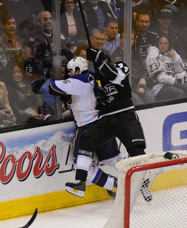 . The Kings Robyn Regehr puts a hit on the St. Louis Blues\' Ryan Reaves. (Michael Owen Baker/Staff Photographer)