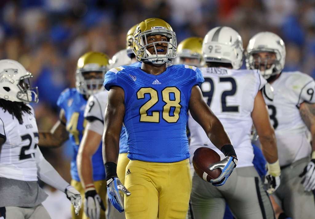 . UCLA RB Malcolm Jones stands after scoring his second touchdown in the fourth quarter against Nevada, Saturday, August 31, 2013, at the Rose Bowl. (Michael Owen Baker/L.A. Daily News)