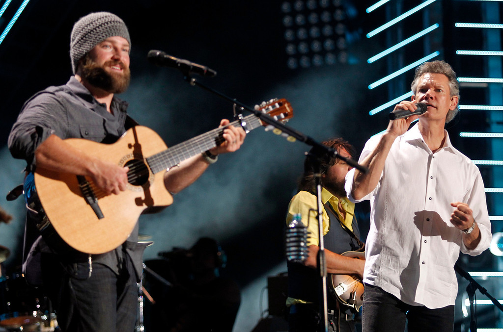 . Zac Brown performs with Randy Travis during the CMA Fan Festival Thursday, June 9, 2011 in Nashville, Tenn. (AP Photo/Wade Payne)