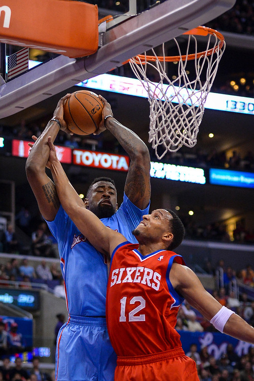 . Clippers� DeAndre Jordan gets the rebound above 76ers� Evan Turner  during first half action at Staples Center Sunday.  ( Photo by David Crane/Los Angeles Daily News )