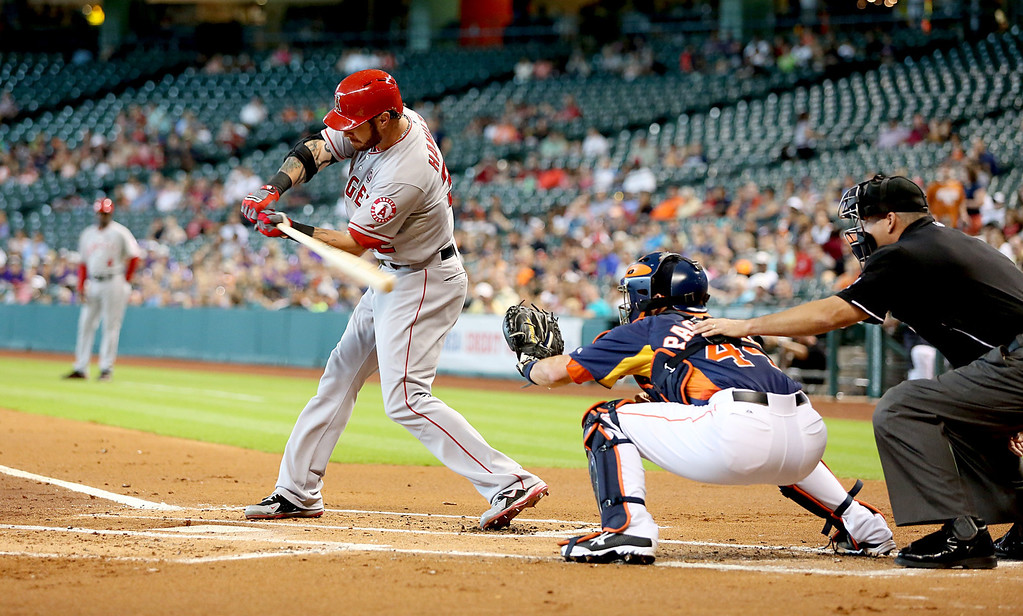 . HOUSTON, TX- SEPTEMBER 15: Josh Hamilton #32 hits a triple RBI scoring Mike Trout #27 of the Los Angeles Angels of Anaheim against the Houston Astros in the first inning on September 15, 2013 at Minute Maid Park in Houston, Texas. (Photo by Thomas B. Shea/Getty Images)