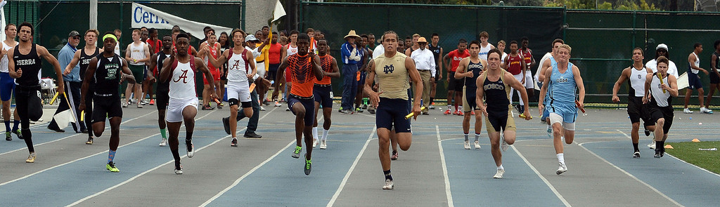 . Notre Dame\'s Koa Farmer runs the final leg of the division 3 4x100 meter race as Notre Dame won the race during the CIF Southern Section track and final Championships at Cerritos College in Norwalk, Calif., Saturday, May 24, 2014. 