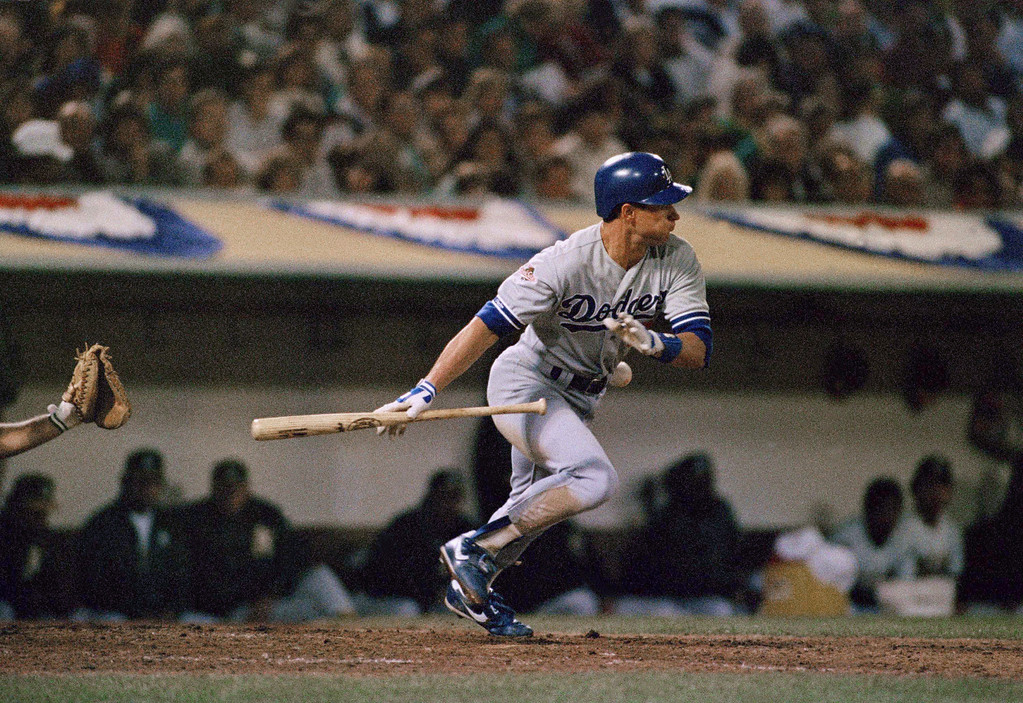 . Los Angeles Dodgers Steve Sax is touched by the ball for an out as he made a vain effort to lay down a sacrifice bunt in the ninth inning of the fourth game of the World Series against the Oakland As at Oakland Coliseum, Wednesday, Oct. 19, 1988, Oakland, Calif. Despite the botched play, the Dodgers won, 4-3, and lead the series 3-1. (AP Photo/Eric Risberg)