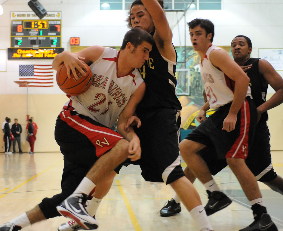 . Narbonne\'s Shailo Leafa (24) guards Palos Verdes\' Matt Costa (21) in a pool-play basketball game of the Mira Costa Pacific Shores Tournament Wednesday. Narbonne won the tight game 60-57. December 01, 2010.  Photo by Steve McCrank/Daily Breeze