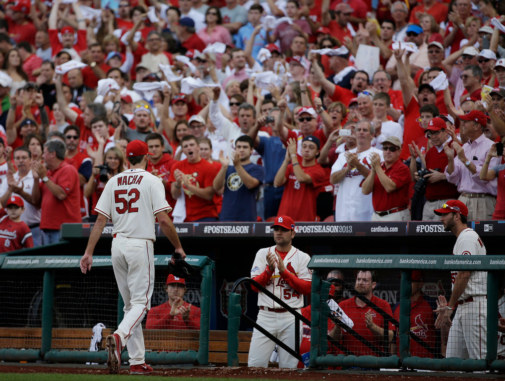 . Spectators cheer as St. Louis Cardinals starting pitcher Michael Wacha leaves the game during the seventh inning of Game 2 of the National League baseball championship series against the Los Angeles Dodgers Saturday, Oct. 12, 2013, in St. Louis. (AP Photo/David J. Phillip)