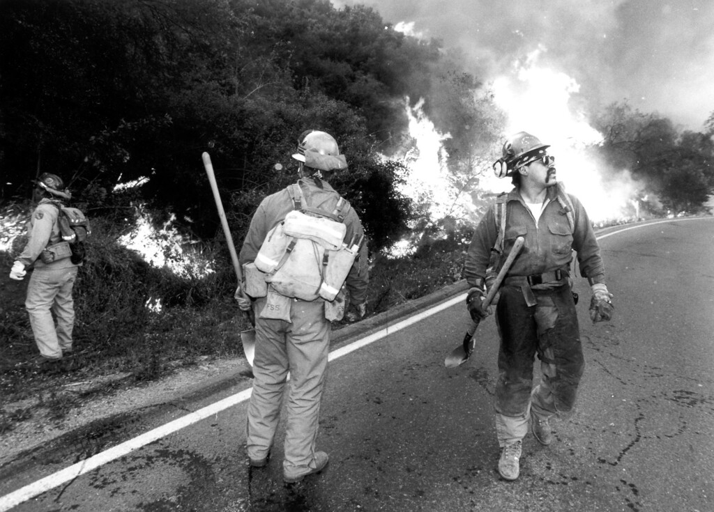 . The Salt Creek crew from Corning, CA, sets a backfire in Topanga Canyon. (11/3/93)   Los Angeles Daily News file photo