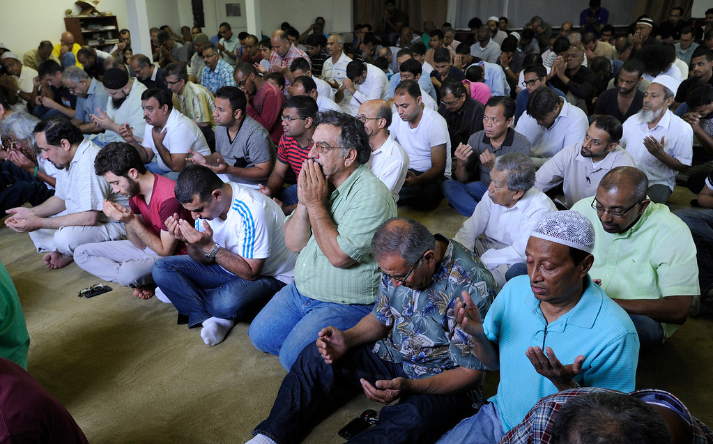. Muslims pray and listen to the Imam Sayed Rashed who gaved a sermon Friday afternoon at the Islamic Center of Glendale. Services focused on the Islamic holy month of Ramadan, a period of inner reflection and devotion to God which starts Monday night. Glendale, CA. 7/5/2013(John McCoy/LA Daily News)