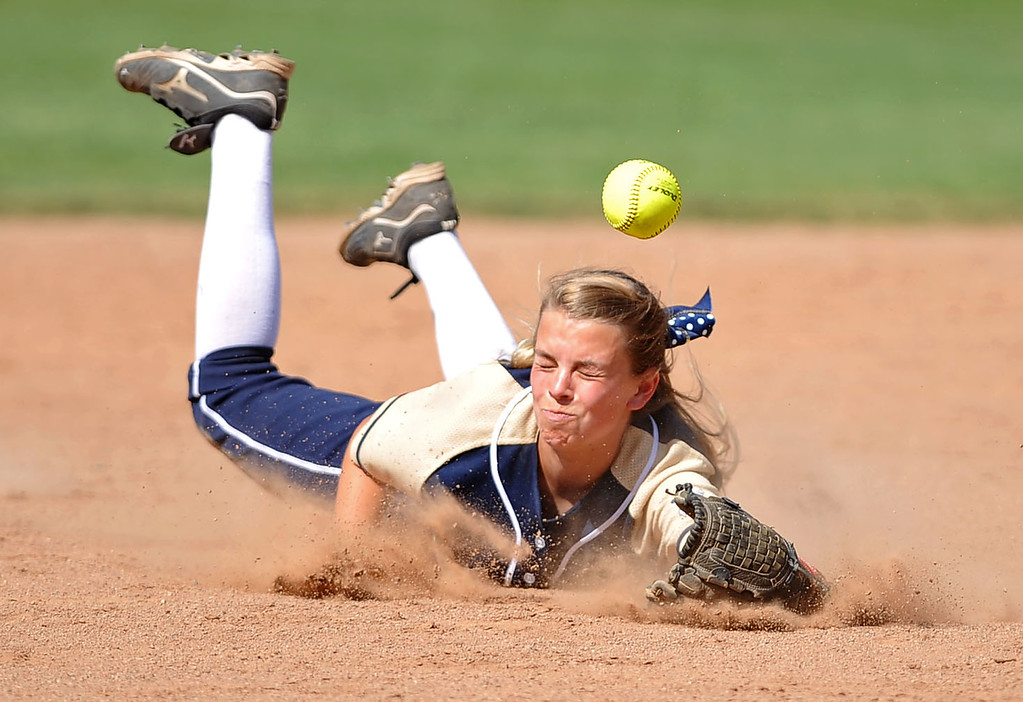 . Notre Dame\'s Annika Pearson can\'t make the play on an Alemany hit during their Mission League softball showdown in Encino, CA April 8, 2014.  Alemany won the game, 5-4.(Andy Holzman/Los Angeles Daily News)