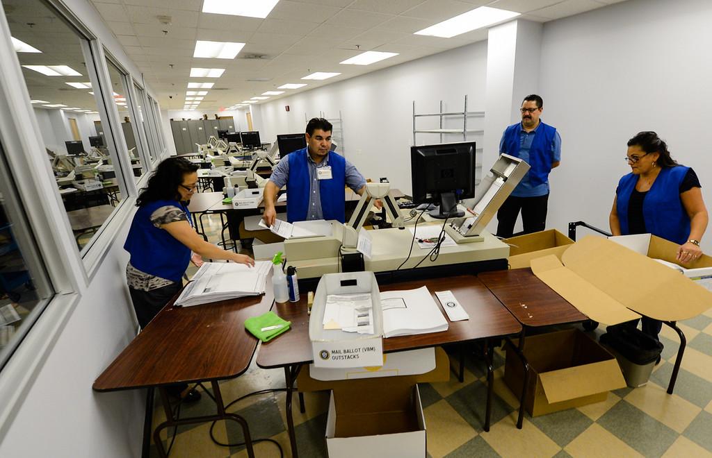 . Ballot counting team employees prepare to count mail-in ballets at the Registrar of Voters office in San Bernardino on Monday, Nov. 4, 2013. (Photo by Rachel Luna / San Bernardino Sun)