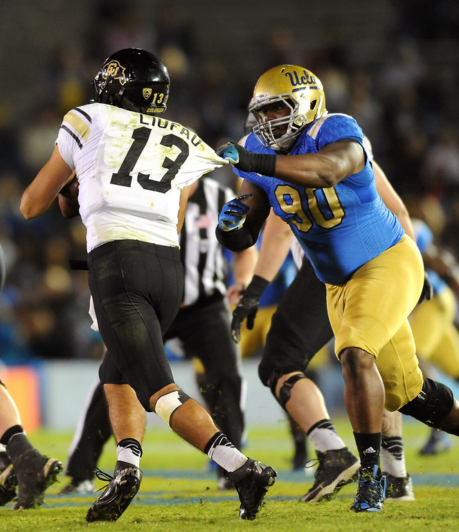 . UCLA\'s Ellis McCarthy sacks Colorado QB Sefo Liufau in the fourth quarter, Saturday, November 2, 2013, at the Rose Bowl. (Photo by Michael Owen Baker/L.A. Daily News)