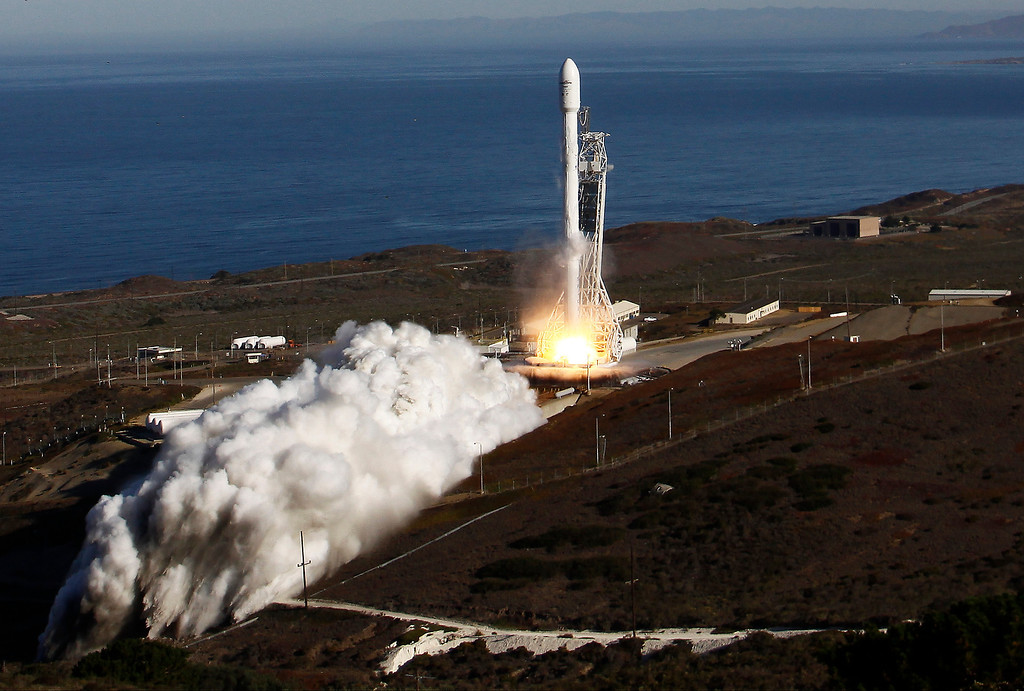 . Vandenberg Air Force Base, Calif. - An upgraded Falcon 9 rocket carrying a small science satellite for Canada blasted off from a newly refurbished launch pad in California today for a key test flight. The company is developing the rocket to  fly cargo and crew to the International Space Station for NASA, carry commercial and non-U.S. government satellites into orbit at a cut-rate price and break a monopoly by Lockheed Martin and Boeing\'s United Launch Alliance partnership for the U.S. military\'s business. Vandenberg AFB CA. Sept 29,2013. Phot by Gene Blevins/LA Daily News