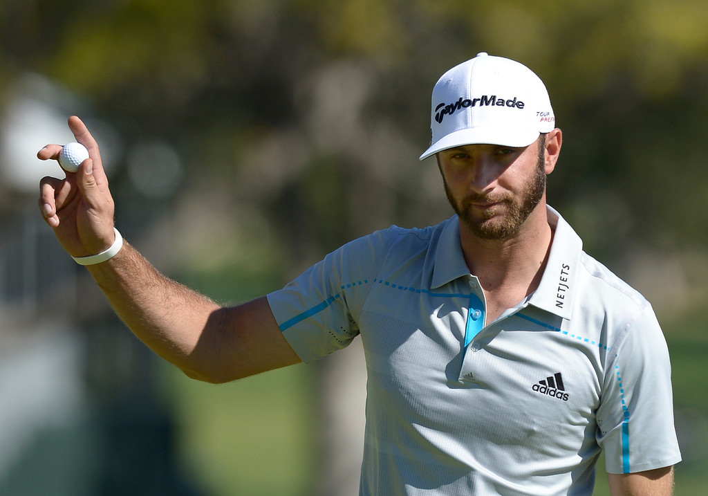 . Dustin Johnson waves to the crowd after making a birdie on the 2nd hole during the second round of the Northern Trust Open. Pacific Palisades, CA. February 13, 2014 (Photo by John McCoy / Los Angeles Daily News)