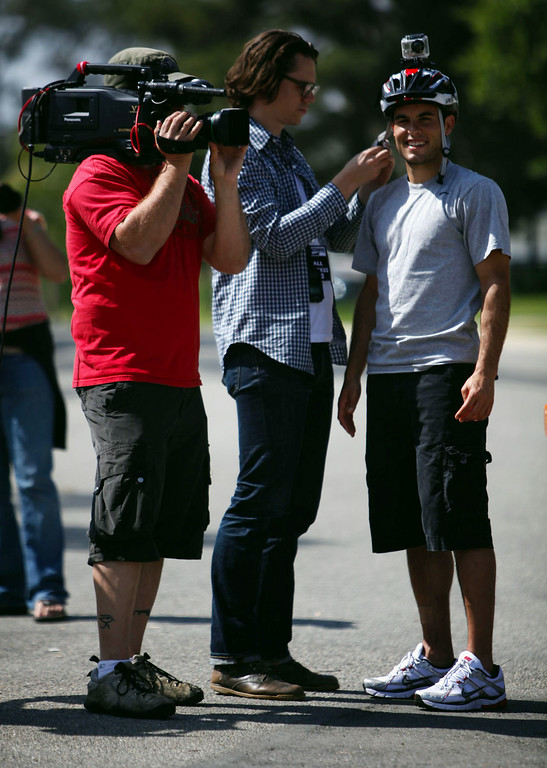 """. Landon Donovan get set up with a helmet camera as he prepares to deliver newspapers on his old newspaper route during the taping of a for the ESPN show \""""Home Coming with Rick Reilly\"""" in Redlands Monday, April 19, 2010. Donovan, now a professional soccer player with the Los Angeles Galaxy, was a paper boy for the Redlands Daily Facts when he was a young teenager. (Staff file photo/Redlands Daily Facts)"""