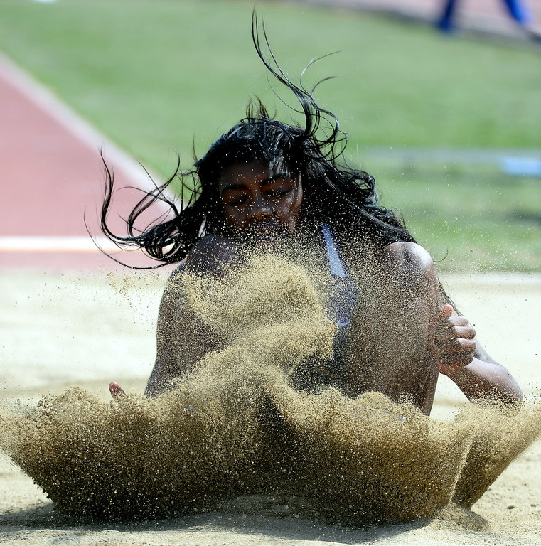 . Long Beach Poly\'s Zhane Smith competes in the long jump Invitational during the Mt. SAC Relays in Hilmer Lodge Stadium on the campus of Mt. San Antonio College in Walnut, Calif., on Saturday, April 19, 2014. 