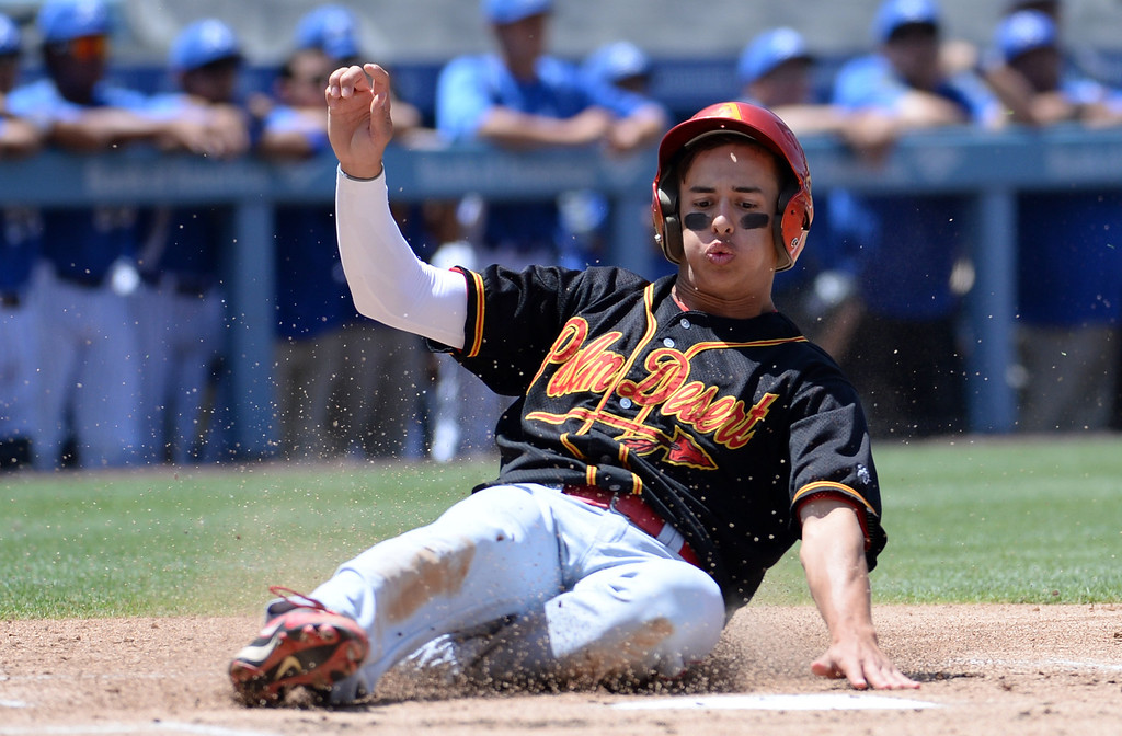 . Palm Desert\'s Andrew Clark scores on a single by Gil Sauceda (not pictured) in the first inning of the CIF-SS Division 3 baseball championship against Bishop Amat at Dodger Stadium in Los Angeles on Friday, June 6, 2014. Bishop Amat won 4-3. 