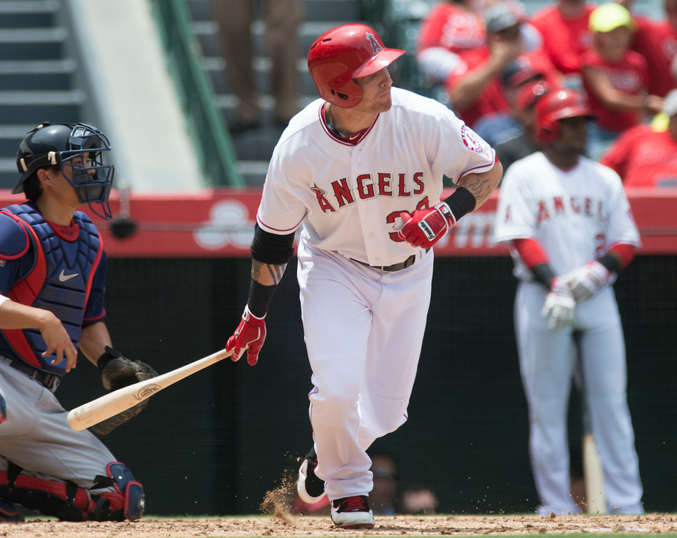 . Josh Hamilton gets a hit as they play the Minnesota Twins at Angel Stadium in Anaheim on Thursday June 26, 2014. (Photo by Keith Durflinger/Whittier Daily News)