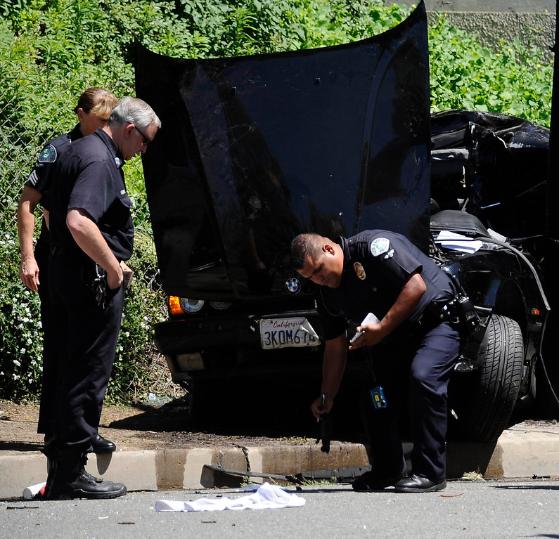 . LAPD at the scene were a BMW going west bound on Burbank BL west of Etiwanda at a high rate of speed lost control and hit at power around 11:15 am. The male driver was killed at the scene and no other cars were involved as the caused is under investigation. Photo by Gene Blevins/LA Daily News
