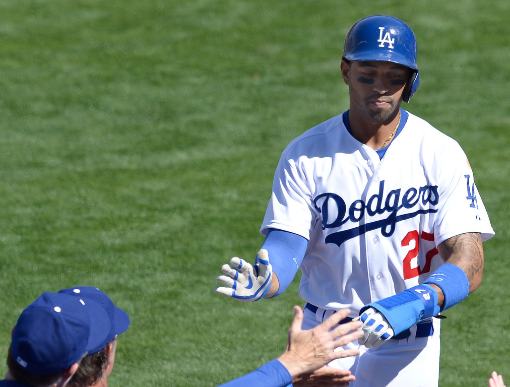 . Matt Kemp is congratulated after being driven in by Andre Ethier in the 5th inning. The Dodgers played the San Francisco Giants on Opening Day at Dodger Stadium. Los Angeles, CA. April 3, 2014 (Photo by John McCoy / Los Angeles Daily News)