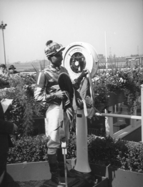 . Jockey weighs in at Hollywood Park in 1938.   (Los Angeles Public Library)