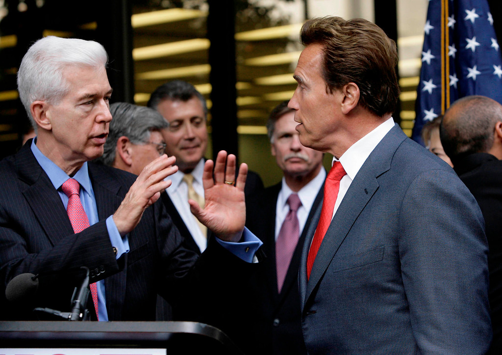 """. California Gov. Arnold Schwarzenegger, right,  listens to former Governor Gray Davis, left, during a \""""No on Prop. 5\"""" campaign event in Los Angeles Thursday, Oct 30, 2008.  Five California governors are in rare bipartisan opposition to a ballot measure they say would harm public safety by easing punishment for drug offenders (AP Photo/Nick Ut)"""